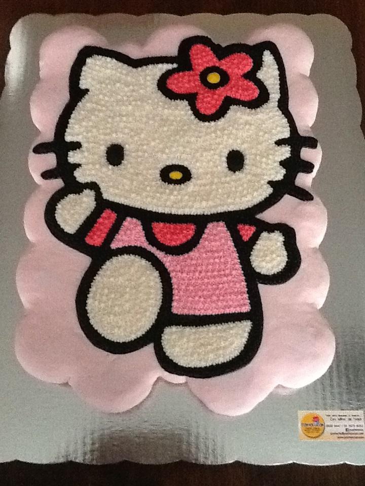 Pastel de panquecitos Kitty, panquecitos de vainilla decorados con betun de chocolate