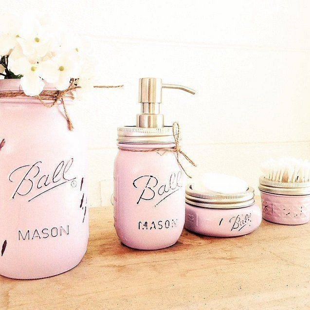 Chalk paint several sizes of mason jars to bring a feminine touch and elegant organization to to your bathroom. Pick a color that complements your bathroom.