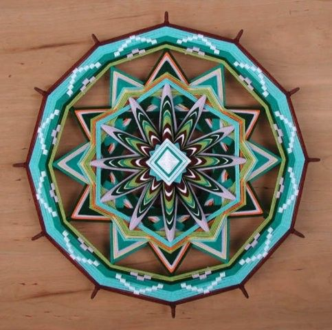 beautiful Ojos de dios on Etsy by jayfroggy - amazing color and designs. Inspiring me ...