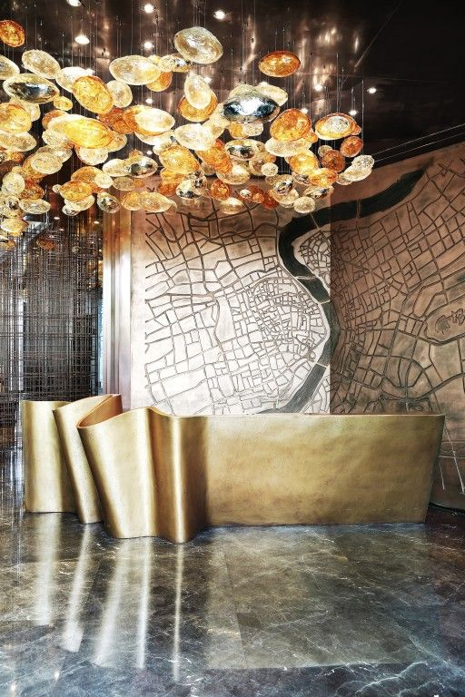 bronze reception desk | International Design Excellence Awards | Greenland Huangpu Riversider Club More