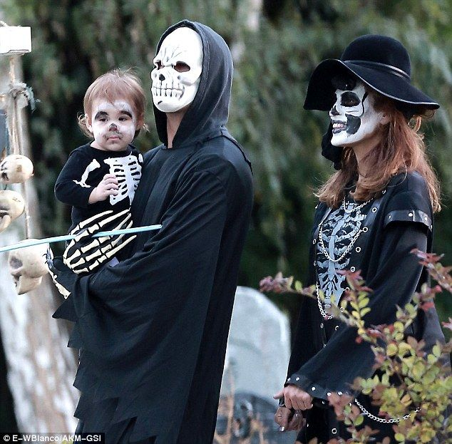 Family outing: Ryan Gosling and Eva Mendes were spotted taking one-year-old daughter Esmeralda trick-or-treating in Los Angeles on Saturday