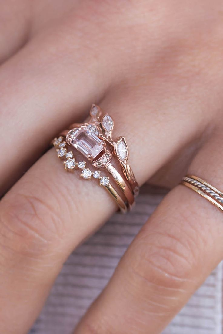 This ethereal band takes us back to a time of romance, grace, and elegance.Set in a stunning, hand-formed 14k rose gold band, four leaf-shaped marquise diamonds are arranged to natural perfection. Di