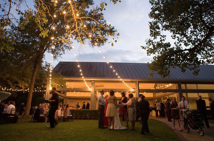lovely wedding at umlauf sculpture garden featuring festoon lighting photo by paige becker photography becker lighting