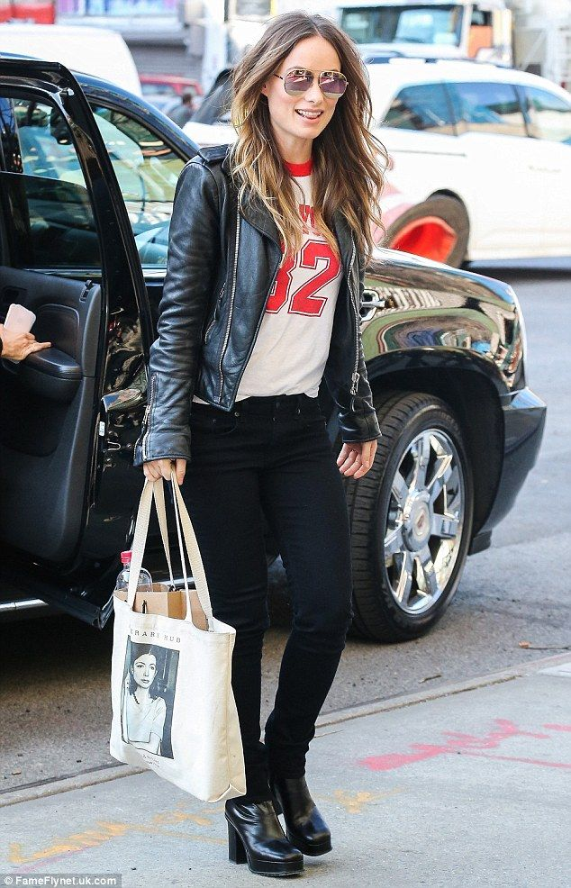 Fashion home run! Wilde donned a baseball themed top, black skinnies, and chunky heels whe...