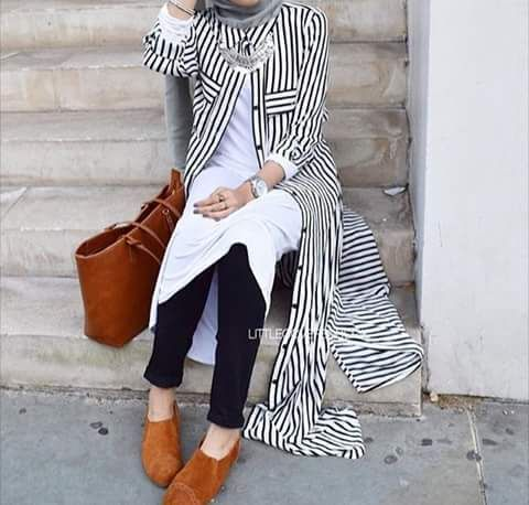 Black pants, white shirt, striped long cardigan, grey scarf, silver necklace, neutral shoes, grey nail polish, rings, watch, silver bracelet