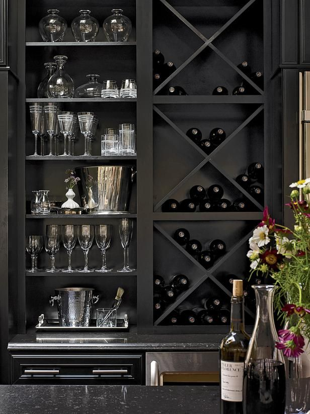 Design Ideas for Kitchen Shelving and Racks: Indulge in luxury. Specialized open cabinetry is a wonderful way to give a prized collection of china, silver, fine wines or other items the pride of place it deserves. Here, X-shaped inserts keep bottles organized, while the shelves for barware are tailored to the heights of the different pieces. A dramatic black finish underscores the elegant effect. Courtesy of KraftMaid From DIYnetwork.com