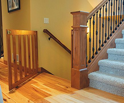 stairway gates - custom wood staircase safety gate with bottom wheel - BILDnow.com via Atticmag