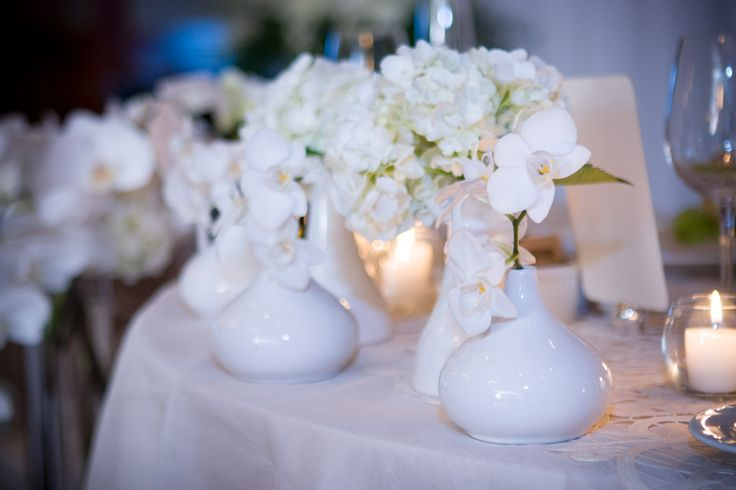 Copper Creek wedding reception pretty white vases and flowers