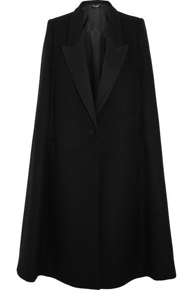 Stella McCartney's cape is smartly tailored from a warm wool-blend and trimmed with contrasting cotton-blend twill lapels. This loose, boxy style is sharpened by padded shoulders and drawn in at the waist by a single button fastening. Layer it over turtlenecks and chunky knitwear.