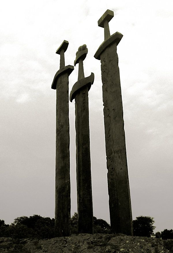 Viking´s Swords in Stavanger, Norway  :: The Three Swords (Sverd i Fjell) monument was unveiled by King Olav in 1983 and commemorates the Battle of Hafrsfjord in 872, after which King Harald Fair Hair united the three districts of Norway into one kingdom.The crowns on the swords represent the different districts which took part in the battle.