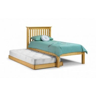 The classic Barcelona bed in antique pine laquered finish with an additional pull out guest bed..