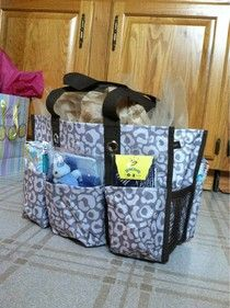 Thirty One Diaper Bag ((looks like LEOPARD!! Hopefully Hoochie Mama has a boy and I can get it embroidered in *BLUE****  I always do this for baby showers and fill them w/ things for Momma and Baby)) lol