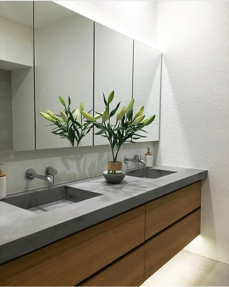 Concrete block topped timber vanity with inbuilt basins, brushed metal tap and mixer, under vanity lights. Project by - @concretenation #concrete #taps #interiordesign #bathroom #australia #architecture #bathroomdesign #bathroomcollective Visit our website for more www.bathroomcollective.com.au