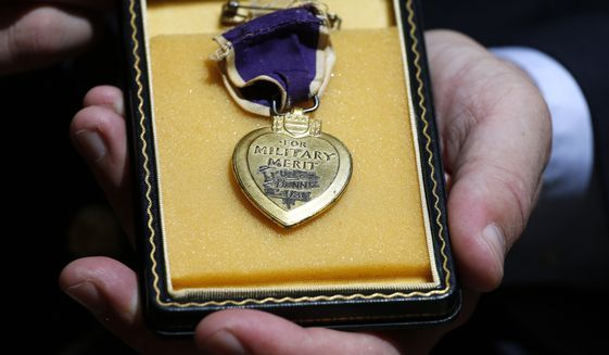 """Victims of the Fort Hood shooting will soon be eligible to receive the Purple Heart, with Congress pushing ahead with a policy change that would officially recognize domestic terrorism as an issue, rather than the """"workplace violence"""" designation the Obama administration had used. (Associated Press) ** FILE **"""