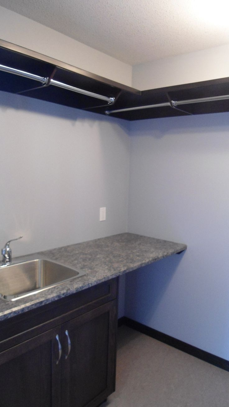 Custom Laundry room with utility sink, and folding counter #laundry