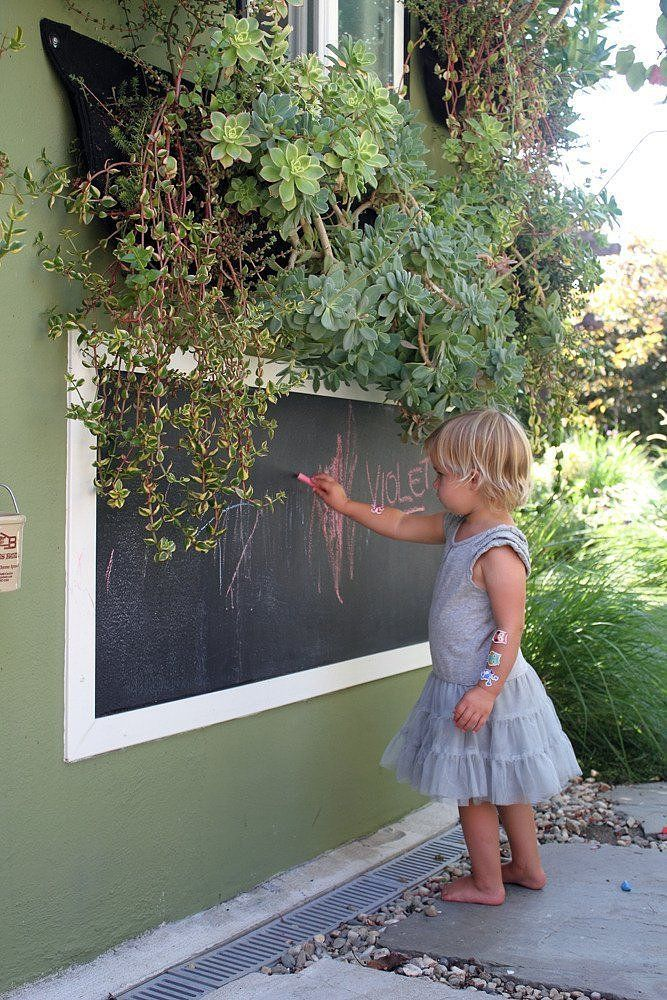 Chalkboard wall in the backyard! Source: Bethany Nauert via Apartment Therapy