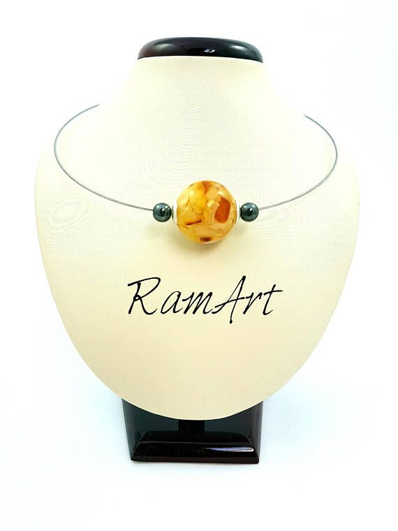 Ball with genuine amber stones embedded in resin surrounded #Christmasgift #gitts #gift #amber #amberball #balticamber #amberpendant