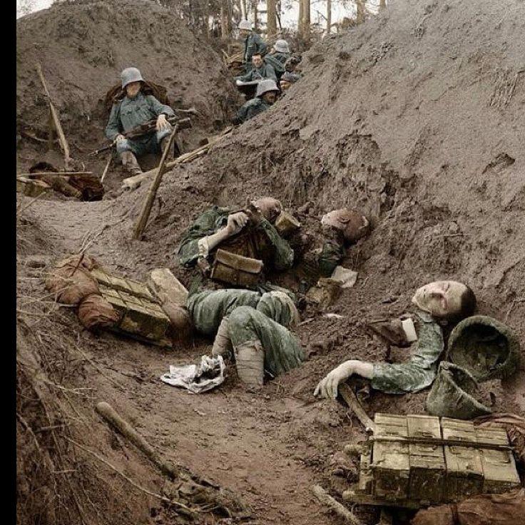 Casualties of war ------------------ German soldiers look upon the bodies of fallen Italian soldiers, Northern Italy, 1916. #WorldWar1incolor