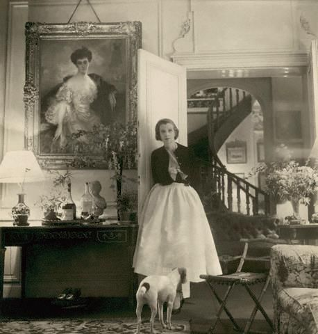 Baroness Philippe de Rothschild (formerly Pauline Fairfax Potter) with dog in the drawing room of her country house Petit Mouton, with Flameng's portrait of Baroness Henri de Rothschild, Baron Philippe's mother, c 1956– Image by © Condé Nast Archive/CORBIS