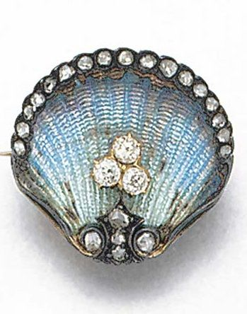 An Edwardian diamond, rose-cut diamond, and enamel brooch. Designed as a clam shell, the inside of pale blue guilloché enamel set with an old-brilliant-cut diamond three stone cluster, with rose-cut diamond lip and base and fluted design reverse.