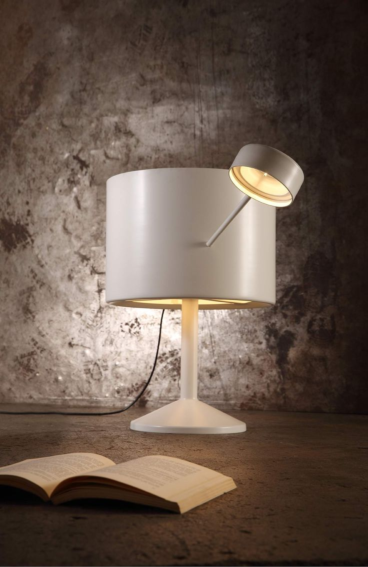 Freccia - Table Lamp -  It's a lamp with a twin illumination that manifests itself as the grafting of two distinct units: there is a strong sensation of a fusion of usually disconnected elements.