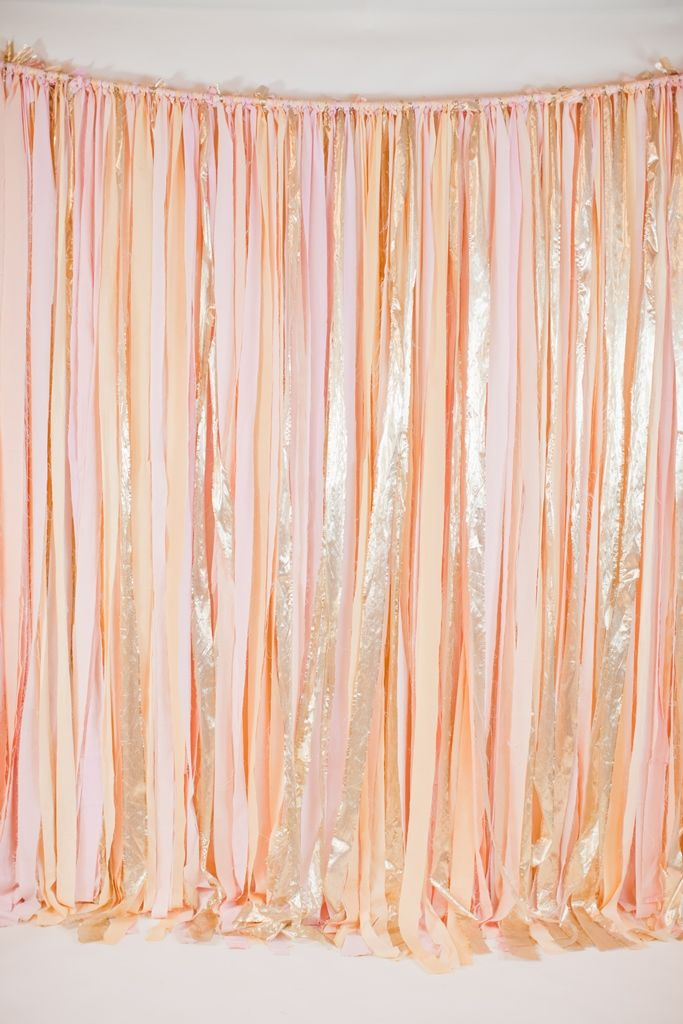 blush+and+gold+ribbon+backdrop: 8'+x+8'+blush,+peach,+and+gold+ribbon+backdrop.+a+low+profile+aluminum+frame+is+available+to+rent+as+well+if+you+don't+have+2+trees+to+hang+this+from.