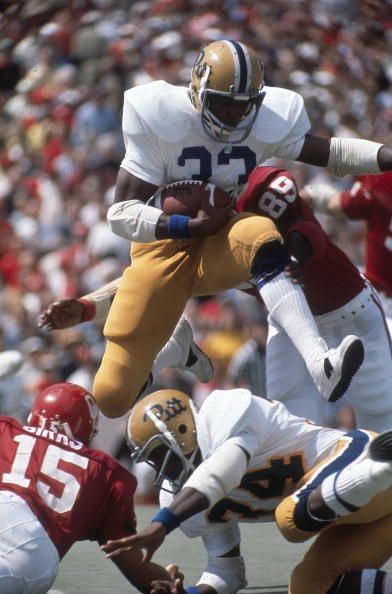 College Football Pittsburgh Tony Dorsett in action jumping over player vs Oklahoma Norman OK 9/20/1975