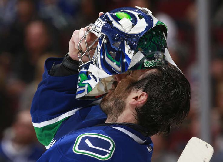 VANCOUVER, BC - FEBRUARY 25: Ryan Miller #30 of the Vancouver Canucks removes his helmet during his NHL game against the San Jose Sharks at Rogers Arena February 25, 2017 in Vancouver, British Columbia, Canada. (Photo by Jeff Vinnick/NHLI via Getty Images)