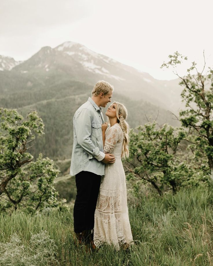 Mountain engagement photos. Perfect cream Free People Dress. Photo by Paris Tews.