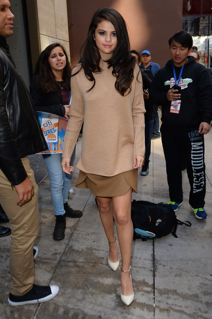Selena wore what might be our favorite look of the day: a camel sweater and a color-coodinating mini skirt with pointed-toe pumps.
