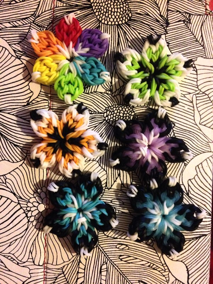 I'm having way too much fun making these rainbow loom flowers ^.^ thinking of selling them