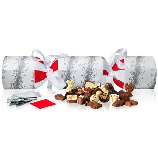 Our striking Rather Large Cracker never fails to raise a smile and a gasp or two. But just wait until the 40 luxury chocolates come tumbling out, complete with 12 party hats and jokes. #hotelchocolat #hcdreamhamper