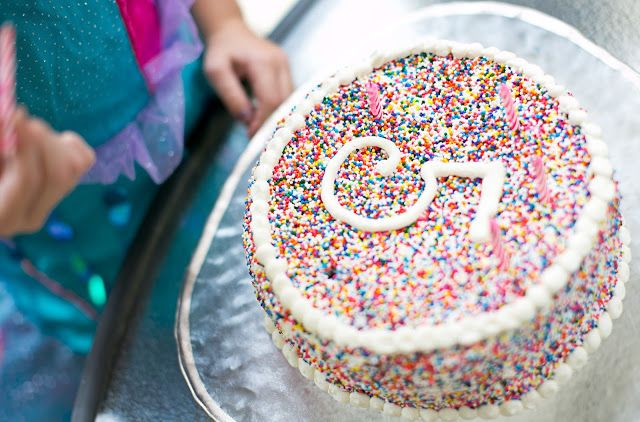 Rainbow sprinkle covered birthday cake