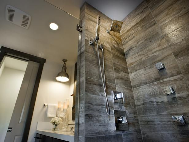 Porcelain tile designed to look like weathered barn wood lines the spacious shower enclosure. Placing the tiles horizontally creates a modern look.    http://www.hgtv.com/dream-home/master-bathroom-pictures-from-hgtv-dream-home-2014/pictures/page-12.html?soc=pindhm