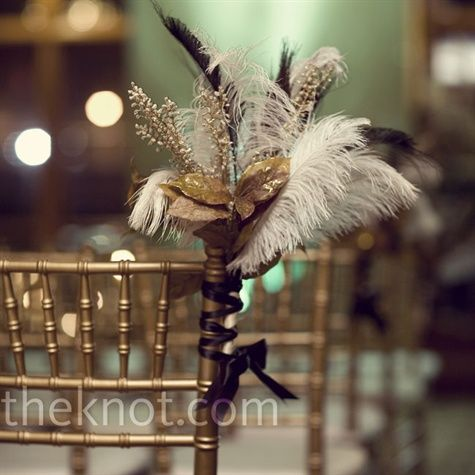 Shannon is allergic to flowers. Instead, they decorated chairs at the ceremony with feathers, gold leaves, and branches.