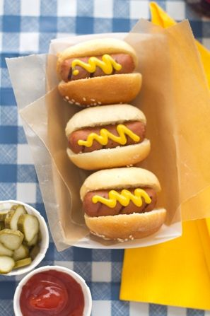 Cute little hot dogs with cute little trays. Love this idea for a 4th of July party.