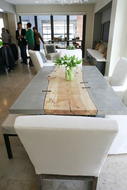 This raw-edge wood plank has been inlaid into this cement table... genius.