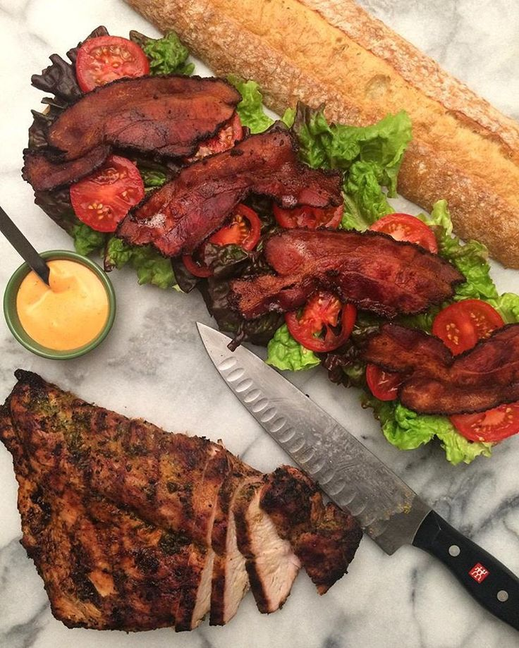 Looking for dinner ideas when I came across a nice boneless, skinless turkey breast... seasoned it with fresh herbs, olive oil and lemon juice, added in some beautiful smoked pepper bacon, fresh vine-ripened tomatoes, red leaf lettuce, sriracha mayo, rustic French batard and we enjoyed a really nice club sandwich.@zimmysnook