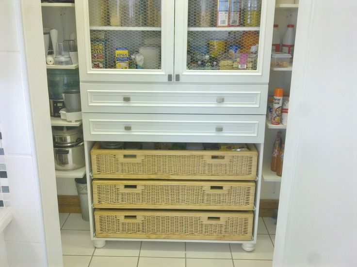 """Country / Farmstyle - Pantry Unit with """"chicken wire"""" and custom made wicker baskets."""