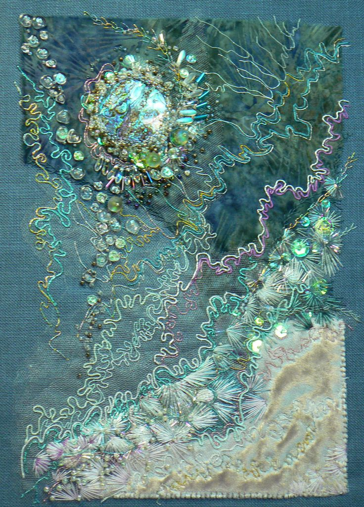 https://flic.kr/p/7CxPnH | Float | Embroidery on blue Belgian linen. Paua shell, beads, sequins. Commercial cotton, netting and salvaged velvet. Metallic and cotton flosses. Approx 8x10 inches.  Based on photo of a bubble trapped in ice formed in a shallow birdbath.  Copyright 2010 Carol Walker