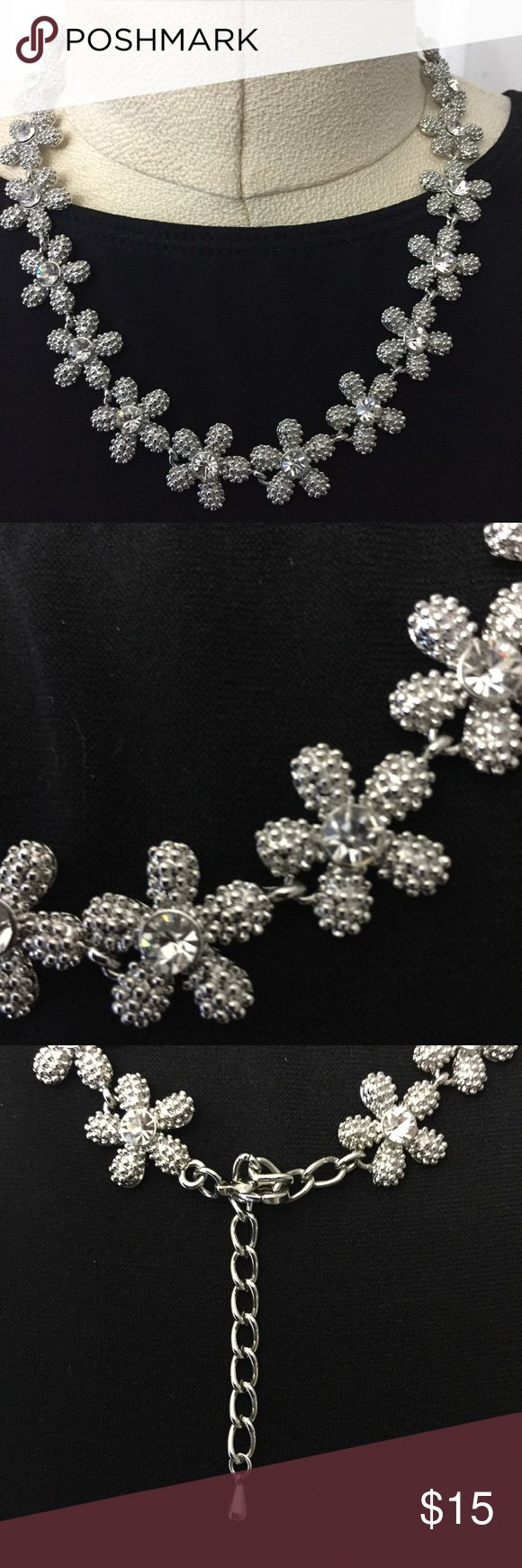"""Silvertone and Rhinestone Chained  Flower Necklace This necklace is SO PRETTY! Photos don't do it justice! Wear with any color. Adjusts from 8-9.5"""" length. Can be worn with a black cocktail dress, a yellow summer dress or denim ... and anywhere in between. Substantial weight ... great quality costume jewelry. New! unbranded Jewelry Necklaces"""