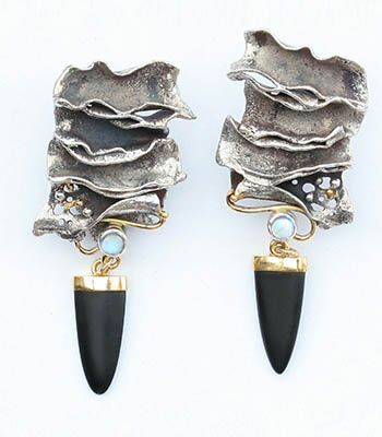 Eve  Llyndorah: Wave Earrings, Sterling silver and 18k yellow gold, with 14k ear clips, blue moonstones, and black onyx drops. 6.7cm x 2cm x...