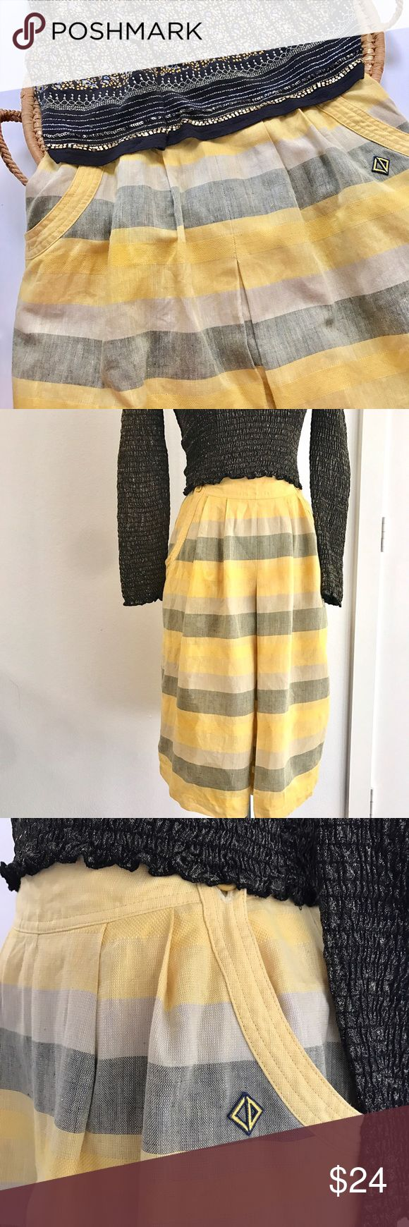 """Vintage Christian Dior sport skirt Vintage Christian Dior skirt size medium. Authentic! Very cute pockets and great color for spring and summer. Style with mixed print cropped top and sandals. Waist flat is 12"""" and length is 24"""".  Has very light spots on bottom, hard to see unless your really close. See last pic Christian Dior Skirts"""