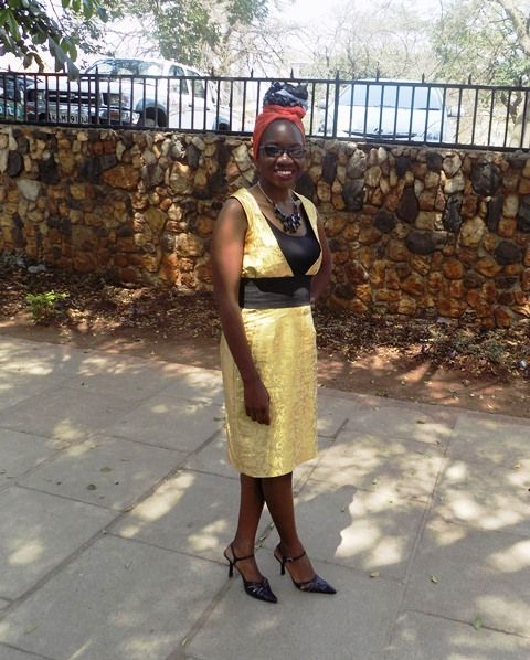 A Gold Dress And Double Headwrap