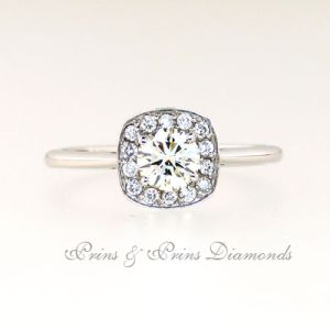 18k white gold thin band with one 0.508ct O VVS2 round brilliant cut diamond set in 4 claw setting with a diamond halo = 0.14 ct 1R06871