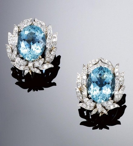 PAIR OF AQUAMARINE AND DIAMOND EAR CLIPS, VERDURA. Each set to the centre with an oval aquamarine within a foliate surround of leaves set with brilliant-cut diamonds, signed Verdura.