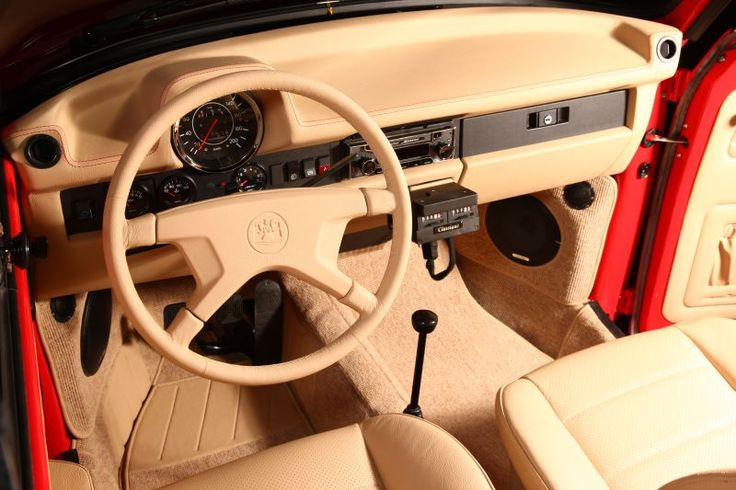 1303 Red Beetle Cabriolet by Memminger, Germany. Memminger Feine-Cabrios & Stahlbau GmbH, based in Reichertshofen, is a company that specializes in the restoration of the models 1302 and 1303 VW convertible, manufactured between 1970 to 1979.