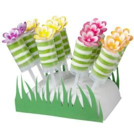 Decorated treat pops add so much fun to any party, like other's Day, bridal showers and garden parties. They a make a pretty presentation dressed up as flowers in the grass surrounded stand!