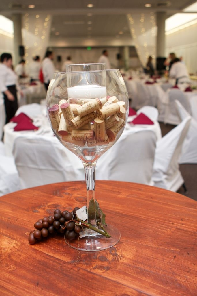 Wine glass cork centerpieces flowers around bottom not for Centerpieces made with wine glasses