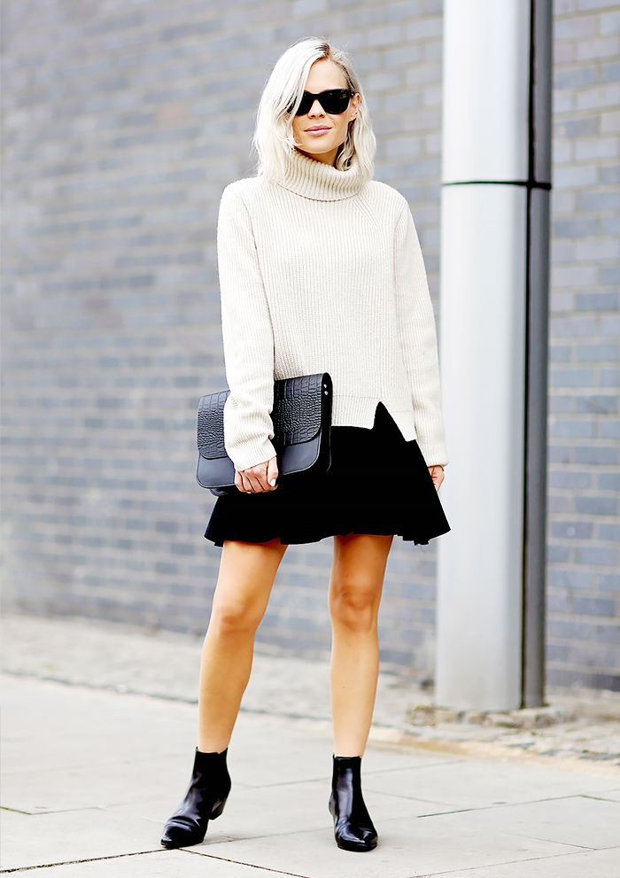 Creme turtleneck worn with black mini-skirt and ankle boots.